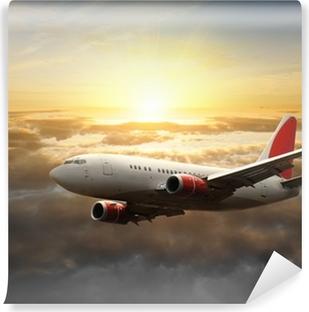 Papier Peint Vinyle Gros avion au coucher du soleil
