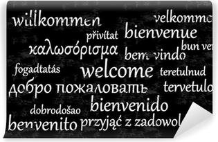 Papier peint lavable Bienvenue écrit dans différentes langues sur un tableau noir