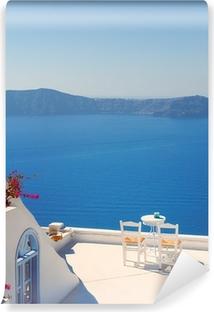 Papier peint lavable Chaises de toit sur Santorin en Grèce