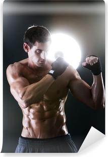 Papier peint lavable Musculaire homme sportif avec une boxe torse nu