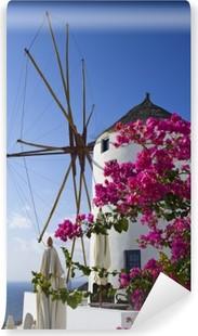 Papier peint vinyle Moulin à vent de fleurs à Oia