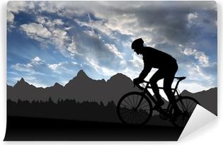 Papier peint vinyle Silhouette du cycliste en vélo de route au coucher du soleil