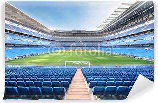 Papier peint vinyle Vider stade de football extérieur avec des sièges bleus