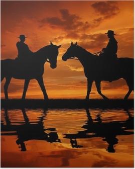 Silhuet cowboys med heste i solnedgangen Plakat