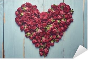 Plakat samoprzylepny Kształt serca róż na drewniane tła