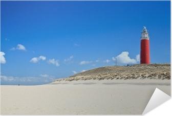 Plakat samoprzylepny Latarnia morska w wydmy na plaży
