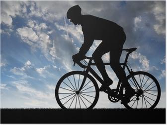 Plakat Sylwetka rowerzysty na rowerze na drogach na zachodzie słońca