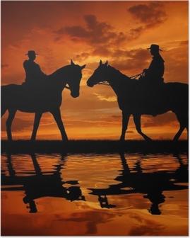 Poster Silhouette Cowboys mit Pferden in den Sonnenuntergang