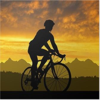 Poster Silhouette del ciclista in sella a una bici da strada al tramonto