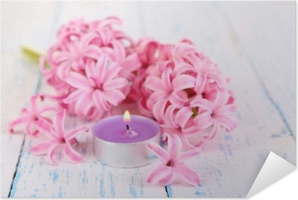 Póster Autoadesivo Pink hyacinth with candle on wooden background
