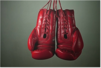 Póster Boxing gloves hanging from laces on a grey background