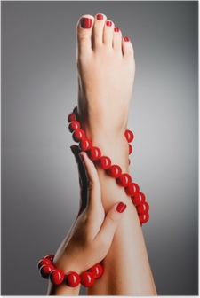 Póster Closeup photo of a beautiful female feet with red pedicure