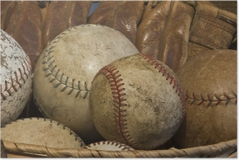 A Basket of Old Baseballs with an Antique Glove Poster