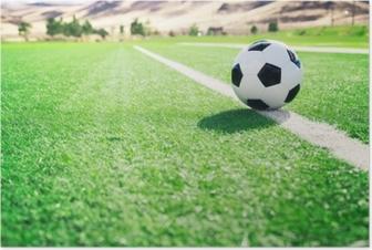Poster Ballon de foot sur un terrain de football