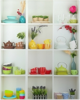 Beautiful white shelves with tableware and decor. Poster