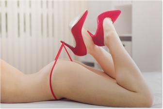 Beautiful woman's legs in heels playing with red panties Poster