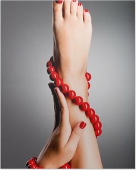 Closeup photo of a beautiful female feet with red pedicure Poster