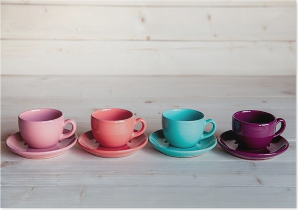 colorful coffee cups on wooden table poster pixers we live to