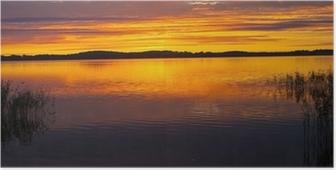 Poster Een kalm meer tijdens zonsondergang