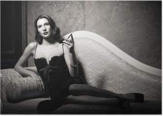 Film noir style: elegant young woman lying on sofa and smoking cigarette. Black and white Poster
