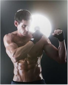 Poster Gespierde sport man met een naakte torso boksen