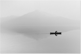 Fog over the lake. Silhouette of mountains in the background. The man floats in a boat with a paddle. Black and white Poster HD