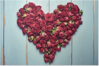Heart shape of roses on wooden background Poster
