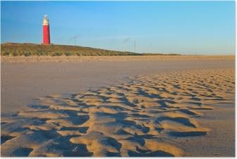 Poster Kust met zandduinen en vuurtoren bij zonsondergang