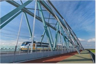 Poster Nederlandse trein passeren van een brug in Nijmegen