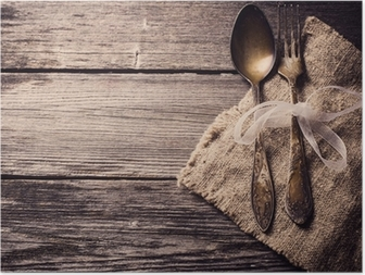 Old fork and spoon on wooden background Poster