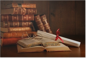 Pile of old books with glasses on desk Poster