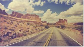 Poster Retro stiliserad scen ökenväg, USA.