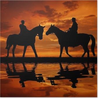 Poster Silhouette cowboys med hästar i solnedgången