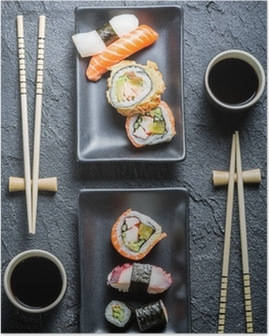Sushi for two served on black stone Poster