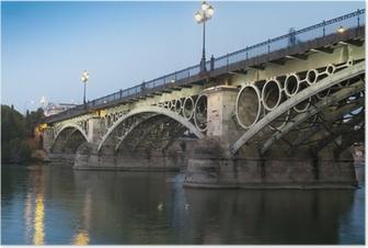 Poster Triana Bridge, de oudste brug van Sevilla bij schemering