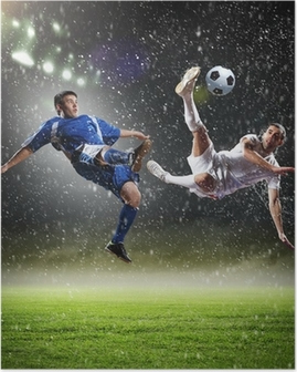 two football players striking the ball Poster