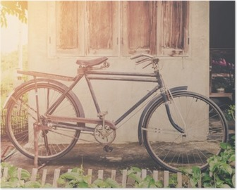 Vintage bicycle or old bicycle vintage park on old wall home. Poster