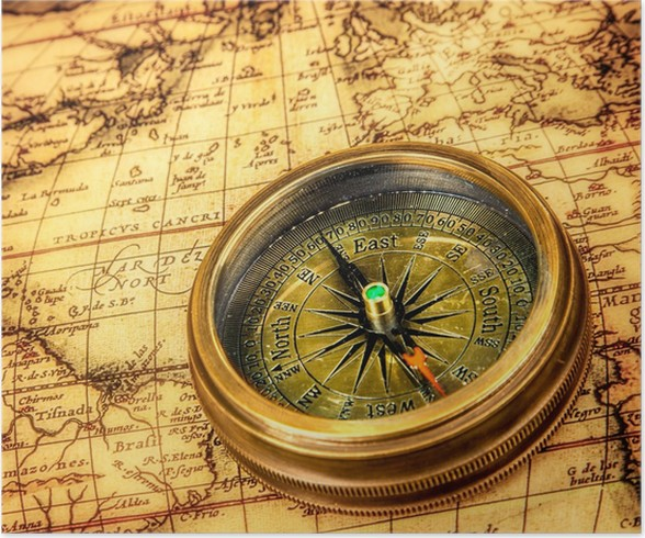 Vintage compass lies on an ancient world map poster pixers we vintage compass lies on an ancient world map poster gumiabroncs Gallery