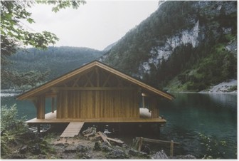 Wood house on lake with mountains and trees Poster