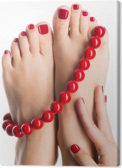 Closeup photo of a female feet with beautiful red pedicure Premium prints