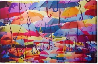 Colorful umbrellas hanging above the street Premium prints