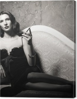 Film noir style: elegant young woman lying on sofa and smoking cigarette. Black and white Premium prints