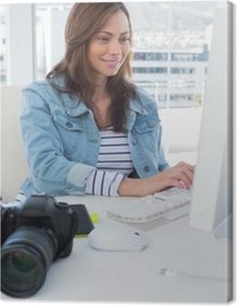 Photo editor working on computer Premium prints