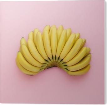 Set ovenfra af modne bananer på en lyserød baggrund. Minimal stil. PVC Tryk