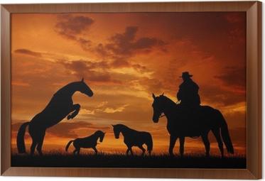 Quadro su Tela Cowboy silhouette con cavalli nel tramonto • Pixers ...
