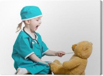 Quadro su Tela Adorabile bambino vestito da medico giocando con il giocattolo su bianco