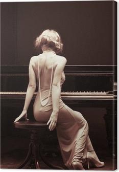 Quadro su Tela Giovane e bella donna attraente in abito da cocktail e pianoforte