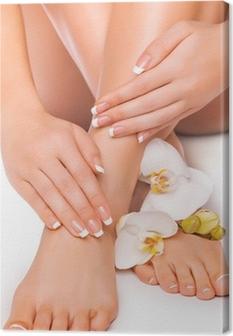 Quadro su Tela Manicure e pedicure con l'orchidea bianca. isolato