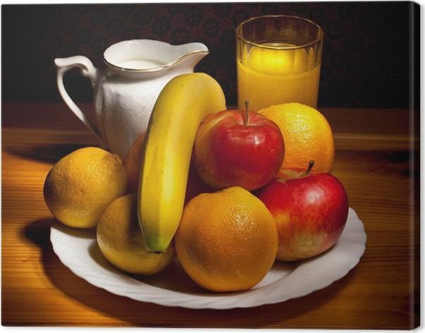 Quadro su Tela Natura morta con arance, mele, banane e un bicchiere ...