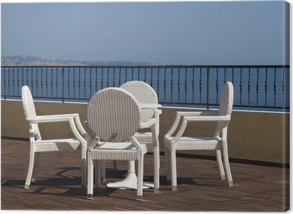 Sedie Bianche E Legno : Quadro su tela sedie di vimini bianche e tavolo su una terrazza in
